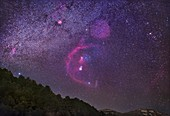 Orion constellation over mountains