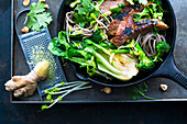 Asian noodle stir fry with grilled duck breast and soba noodles
