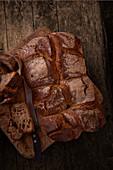 Dark bread on a wooden base