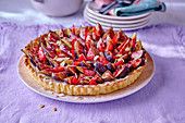 Fig and strawberry tart with flaked almonds