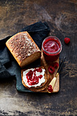 Wholemeal bread with quark and raspberry jam