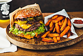 Burger with fried onions, cheese and lettuce leaf