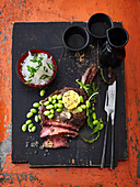 Tomahawk steak with miso butter and edamame