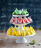 Tricolor meringue drops on a cake stand