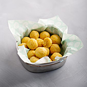Polenta and coconut balls with dried mango