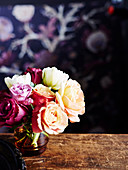 Bouquet of roses on vintage wooden table