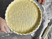 Vegan shortcrust pastry in a baking pan