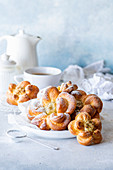 Flower shaped yeast buns with lime curd filling