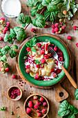 Raspberry ravioli with cream (or dumplings, called vareniki in Russian)