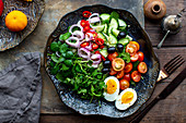 Colourful raw salad with boiled egg