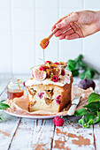 Fig and raspberry cake drizzled with honey