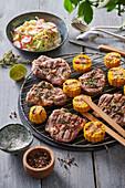 Grilled pork chop, corn and vegetable salad