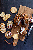 Cheese ball with cherries and almonds