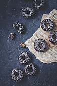 Donuts with chocolate glaze and coconut shreds