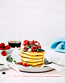 Pancakes with maple syrup and raspberries for Valentine's Day
