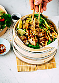 Dumplings with pak choi in a steamer basket
