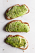 Sandwiches with cream cheese, avocado, pepper and cress