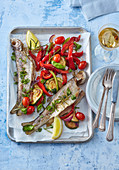 Butter trout with herbs and baked vegetables