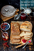 Homemade breads with jam and honey