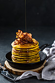 Sweet potato pancakes with crispy bacon and maple syrup