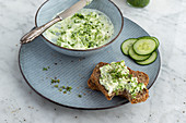 Wild garlic sheep's cheese cream on wholemeal bread with cucumber slices