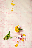 Pea pod, radish slices and edible flowers