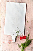 Kitchen board with kitchen twine and dill