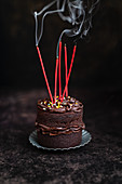 Mini chocolate cake with blown-out candles