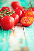 Vine tomatoes on a turquoise wooden background