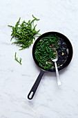 Fried samphire in a pan