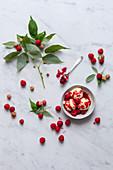 Vanilla ice cream with raspberry sauce and jam
