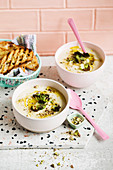 Cauliflower and leek soup with crisp sprout leaves