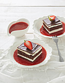 Creamy slices with strawberry sauce