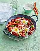 Bean pan with fried eggs