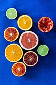 Halves of different citrus fruits