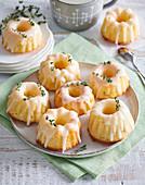 Mini yoghurt bundt cakes with orange peel and thyme