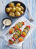 New potatoes with vegetable shashlik and aioli mayonnaise