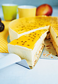 An exotic cake with coconut sponge and a passion fruit topping