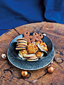 Gingerbread men, florentines and sandwich biscuits