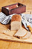 Sourdough bread in a wooden baking frame