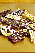 Chocolate bars with nuts, almonds and cranberries