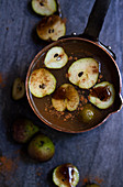 Copper pot with apple cider with small seckel pears, cinnamon and vanilla bean syrup