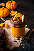 Millet pumpkin pudding with chocolate, oranges and honey