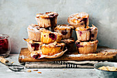 Raspberry yoghurt muffins with flaked almonds