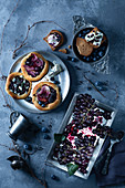 Blueberry pizzas with grapes and pears in blueberry juice