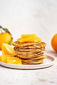 Sourdough Pancakes with sliced orange