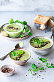 Green pea soup with grain topping