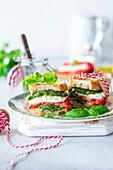 Pesto tomato sandwich with mozzarella