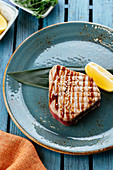 Grilled tuna with herbs and lemon
