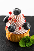 Cupcake with buttercream and blueberries